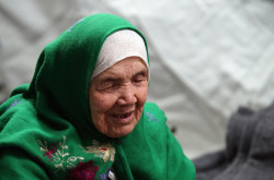 105-year old Afghan regugee Bibihal Uzbeki from Kunduz, Afghanistan, rests in Croatia's main refugee camp at Opatovac, Croatia, near the border with Serbia, Tuesday, Oct. 27, 2015.  Centenarian Bibihal Uzbeki, crossed into Croatia on a stretcher from Serbia with a large group of refugees, including her son and several other relatives, among tens of thousands who have traveled across continents, fleeing war and poverty to search for a happier, safer future in Europe. (AP Photo/Marjan Vucetic)